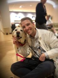 Jesse O'Shea and YNHH therapy dog Rochelle are all smiles during a recent visit.